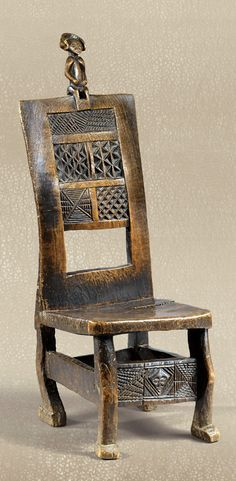 Africa   Chair from the Chokwe people of Angola   Wood; carved with male figure at the top wearing the traditional dignitary's 'Mutwe wa Kayanda' hairstyle