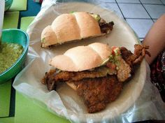 Torta de Milanesa… toda una tradición.   Breaded steak (thin cut) Torta… delicious… a staple. Some places will use beans as the bread spread, thick avocado slices…. mmm come to papa!