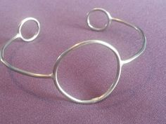 Check out this item in my Etsy shop https://www.etsy.com/listing/226713197/circle-cuff-bracelet
