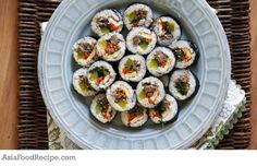 """Kimbap is the Korean version of the Japanese """"maki,"""" or rice rolls. The flavor comes from sesame oil and individually seasoned meats and veggies."""