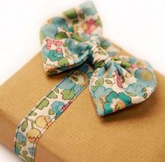 If only it were turned the other way, this lovely little fabric bow could double as a bow tie!