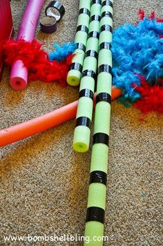 Make truffula trees using pool noodles and feather boas! BRILLIANT!! Perfect for classrooms or a Dr. Seuss bedroom!