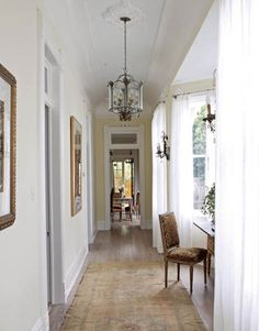 The side hall distinguishes this type of New Orleans house.   - HouseBeautiful.com