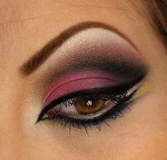 Mulberry smokey eye. The contrast between the eyebrow and the eyeliner, both of them being so starkly drawn, it's very intriguing.