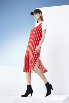 Layer your stand-out strip slip dress over a simple tee and pair with knit accessories for a fresh spring look.