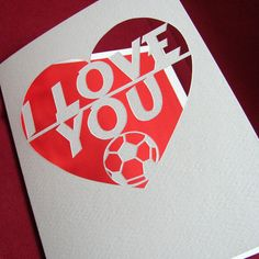 This hand drawn and hand cut card has the message I Love You and a football detail on it. Maybe you would like to change the football to https://www.etsy.com/listing/269360726/heart-papercut-anniversary-wedding-card
