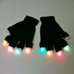 Black Rave Gloves - Standard 8 LED Glove Set - For Light Shows Rave Party - High Quality Durable by GloFX. $14.99. Pre Assembled and 100% ready to use right out of the box!. Includes (2) TWO Gloves with 8 LED Finger tips. Utilizes 8 super durable Photon Style Microlights: Assorted solid colors. This is your Standard Glove Set. Batteries Included. This is a super durable microlight glove set assembled in the USA, not a cheesy prewired set from china!  With GloFX Glove sets, W...