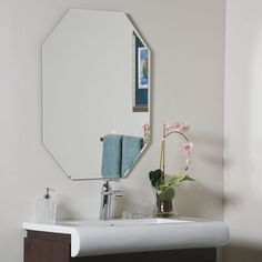 <li>Add an elegant touch to any interior space with the frameless octagon beveled mirror<li>Mirror expertly crafted from 2 levels of thick, strong 3/16-inch glass and metal<li>Wall mirror boasts a stylish contemporary design