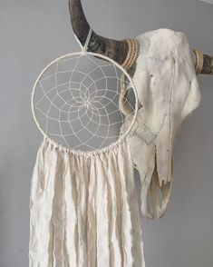 Dream Catcher - Dreamcatcher - Boho Decor - Boho Dreamcatcher The Aurelia dreamcatcher is a perfectly simple and beautiful wall hanging. The web is lovingly hand woven in an off white/ cream colored thread, blending perfectly with the off white/ cream fabric tightly spun around