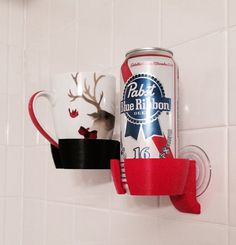 the shower beer holder was born. Below you can find 10 shower beer holders that will make your life a little bit better. Thanks to these dreamers shower bee Wine Glass Holder, Drink Holder, Cup Holders, Take My Money, Take A Shower, Glass Vessel, My Living Room, Simple Weddings, Beer Bottle