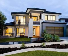 bluestone modern house exterior with balcony & feature lighting