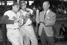 Barber, or The Ol' Redhead, called play-by-play for four decades with the Cincinnati Reds, Brooklyn Dodgers and New York Yankees. Barber (shown with Pee Wee Reese and Gil Hodges) recruited a young aspiring broadcaster named Vin Scully for CBS football coverage and eventually invited him into the Dodgers' broadcast booth to succeed Ernie Harwell in 1950.