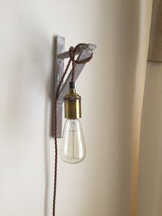 Wall sconce from spare wood in shed
