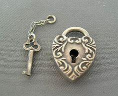 Sterling lock charm