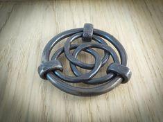 Trivet for kitchenhand forged by blacksmith.