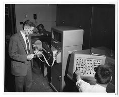 Examining a paper tape input on an early version of a UNIVAC computer at Georgia Tech