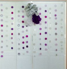 """Diy streamers. Used card stock, 2"""" inch punch hole from Michael's and fishing wire."""