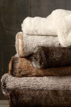 WHITE - Sumptuous softness, perfect for long cozy afternoons in front of the fire. Luxe Faux Fur Throws from Restoration Hardware.