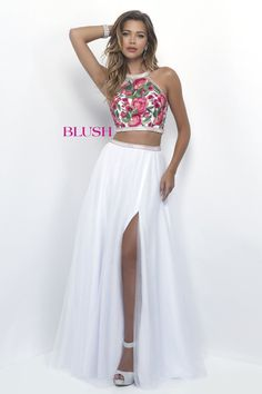 Prepare yourself to receive compliments in this gorgeous embroidered floral and tulle two piece dress! And it's at Rsvp Prom and Pageant, your source for the HOTTEST Prom and Pageant Dresses!