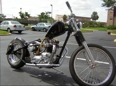 Bonneville (twin carbs), with stretched hardtail and later model Sportster forks.