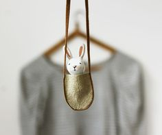 WANT!! Bunny necklace - Paper clay miniature white rabbit in a bag - Wearable art.