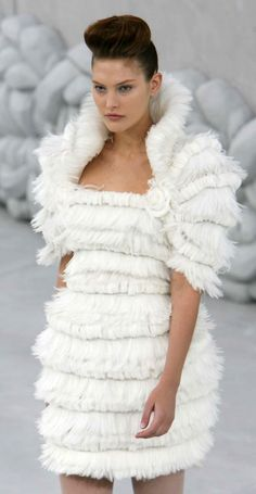 Chanel || the craftsmanship is exquisite, but seriously, what woman is going to wear a dress that makes her look like the Michelin man?