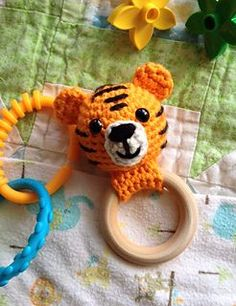 Tiger Teether Ring Baby Rattle Free Crochet Pattern The Tiger Teething Ring is a fun and simple crochet amigurumi pattern … Lion Crochet, Crochet Baby Toys, Crochet Baby Booties, Crochet Animals, Crochet For Kids, Crochet For Beginners, Free Crochet, Simple Crochet, Easy Crochet Patterns