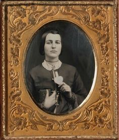 ca. 1850, [daguerreotype portrait of a woman with love token and daguerreotype] via the Nelson-Atkins Museum of Art, Photography Collection