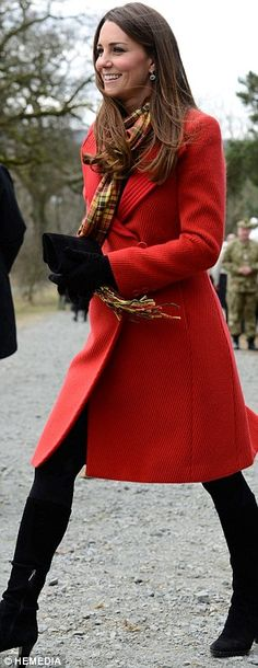 The Duchess of Cambridge wore a red Armani coat and her Strathearn tartan scarf for a visit to the new Tamar Manoukian Outdoor Centre at Dumfries House in Ayrshire today. April 5, 2013