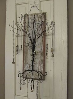 Coat Hanger Jewelry Tree Hint hint i want i want !!!! I know where I can get all the wire hangers we need my craft angels
