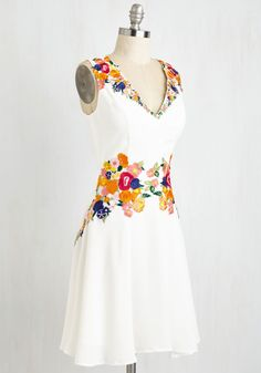 Queen of the Conservatory Dress. Like a wearable floral fantasy, this bright white dress by Chi Chi London is overflowing with vibrant blossoms and blooms! #white #modcloth