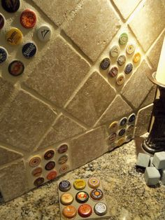 Bottle-cap back-splash. Fun idea for your household bar