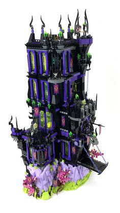 https://flic.kr/p/WeETDv | The Shadow Tower | This is my version of the official Lego set, 41180: Ragana's Magic Shadow Castle, which was built for Brickworld Chicago 2017. More images can be found on Eurobricks This was a fun little build to construct...and a build that turned out to be not so little. I loved the set this was inspired by, so it was somewhat of a dream build of mine to make a larger version and this recent Brickworld seemed like the perfect opportunity to complete that dream