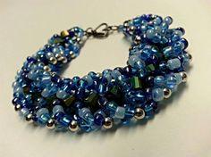 Blue Iridescent Spiral Beaded Bracelet, Blue Iridescent Beaded Bracelet, Blue Bead Bracelet, Beaded Bracelet, Blue Bracelet, Bracelet by SyriousShinies on Etsy