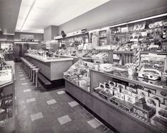 Early 1950s lunch counter somewhere in northern New Jersey that sold candy, cigars, small gifts and toys. Remember these?