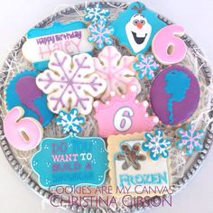 Disney's Frozen Cookies; Frozen Party; Snowman Party; Olaf; Anna; Elsa; snowflake cookie; decorated cookies; let it go