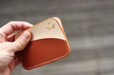 KARTU cardholders. Made from european vegetable tanned leather and glazed kangaroo hide. Finished with hand painted edges and au chinois linen thread.