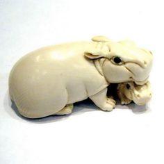 Mammoth Ivory Netsuke. Mother and baby hippopotamus.