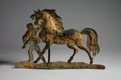 Length 26 inches. This horse and groom weathervane is one of a very few extant and is the best example known.