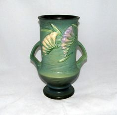 We are offering this beautiful green Roseville 9 1/2 handled vase in the Freesia pattern. It is marked on the bottom Roseville U.S.A. 123-9.