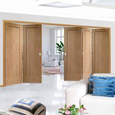 Thrufold Pattern 10 Oak 1 Panel 3+2 Folding Door - Lifestyle Image.    #oakshakerdoors #interiorfoldingdoors