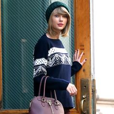 Today's Style Secret Taylor Swift looks model perfect in this apres-ski winter look...We love the color of her boots!
