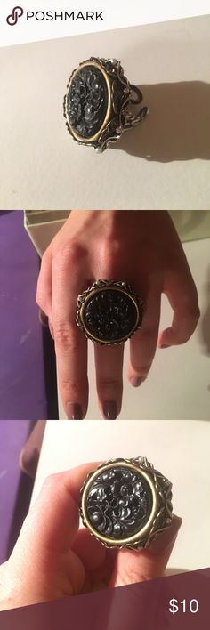Ring. NWOT Really cool black, silver and bronze ring. Jewelry Rings