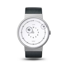 Zoomin Watch is a concept based on a lens features. Both, hour and minute hands have a small lenses integrated to magnify little digits from the clock face.     Designed in collaboration with Emre Cetinkoprulu.