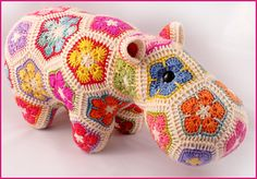 This pattern is available for $6.50 USD - Happypotamus is the second of my patterns that makes use of the African Flower hexagon crochet motif and variations thereof, joined in a specific order to make a recognizable 3D toy. Happy is made using four different African Flower motifs: Hexagon, Pentagon, Heptagon and Octagon. It's also an excellent stash buster project, as you only need to use very small amounts of leftover sock yarn to make a motif.