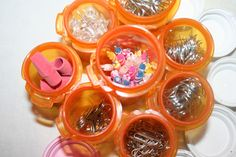 Crafty ways to re-use empty medicine bottles  erasers, birthday candles, paper clips, push pins, safety pins.