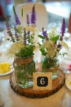 Rustic Wedding Table Centrepieces: Wood and Flowers