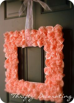 Dollar Store items to make a wreath.  You can choose whatever color you want for the tissue paper roses!  Cute for door or wall decor!  :)
