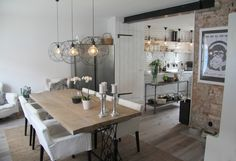 Rustic kitchen / diningarea. Design by Carola Sahlen. Love the lamps and the ape-poster.