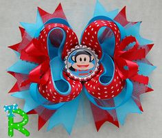 Very cute hair bow for your princess bow collection , this bow is made of grosgrain ribbon with Julius Jr as embellishment . is attached to a